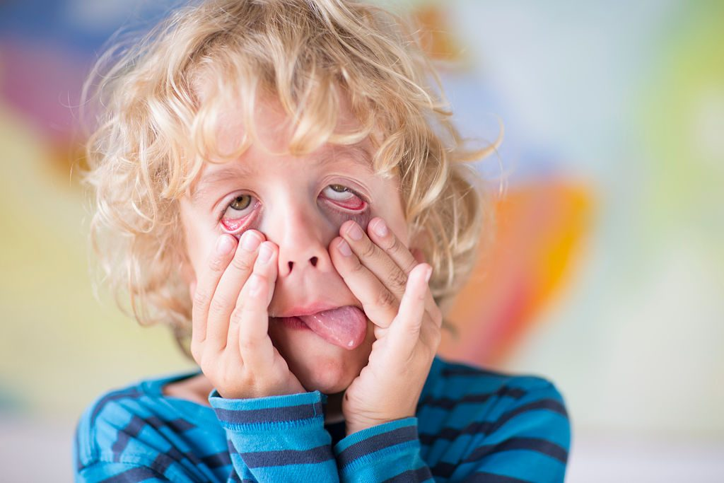 SANKT AUGUSTIN, GERMANY - AUGUST 05: Portrait of a six-year-old boy making faces on August 05, 2014, in Sankt Augustin, Germany.  Photo by Ute Grabowsky/Photothek via Getty Images)***Local Caption***
