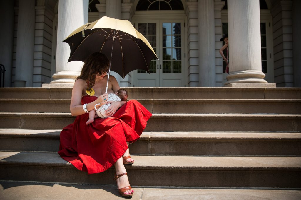 NEW YORK, NY - AUGUST 08: Kiki Valentine breastfeeds her 9-week-old son, Hart Valentine, on the steps of City Hall during a ralley to support breastfeeding in public on August 8, 2014 in New York City. The event was organized by the New York City Breastfeeding Leadership Council, which advocates for the social acceptance of allowing women to breastfeed in public. (Photo by Andrew Burton/Getty Images)