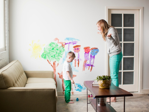 USA, Utah, Salt Lake City, Mother telling toddler boy (2-3) off for painting on walls