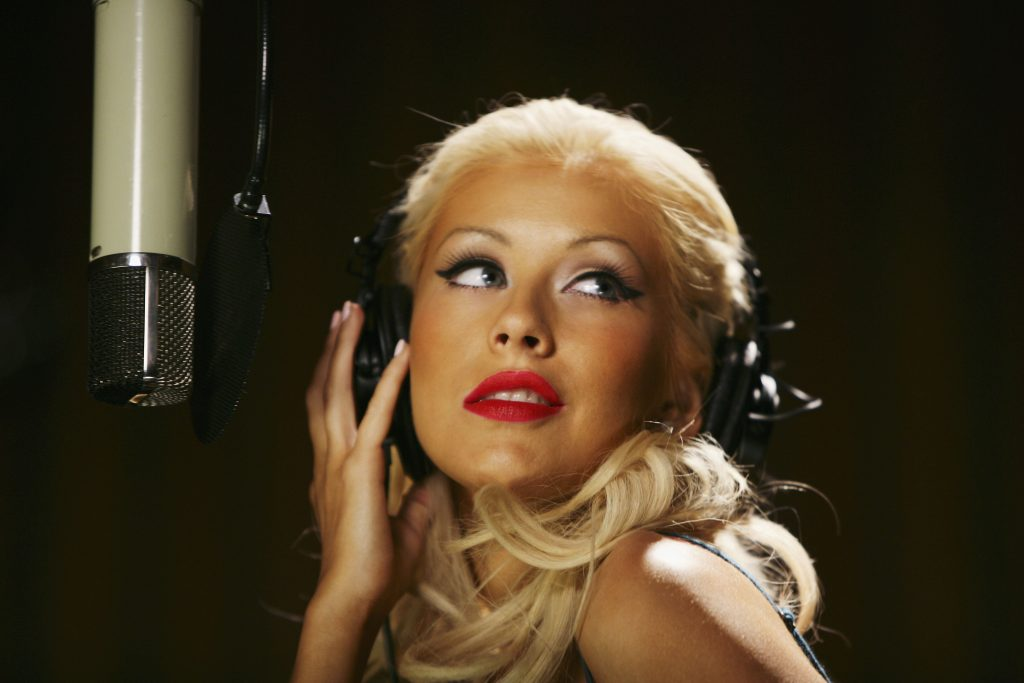 UNSPECIFIED : U.S. pop diva Christina Aguilera strikes a pose during the shooting of the latest global Pepsi commercial. The campaign called downloaded features Aguilera in a number of exotic locations, and allows fans to download a personal performance of their choice. (Photo by Clive Brunskill/Getty Images for Pepsi)