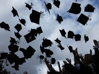 BIRMINGHAM, ENGLAND - JULY 14:  Students throw their mortarboards in the air during their graduation photograph at the University of Birmingham degree congregations  on July 14, 2009 in Birmingham, England. Over 5000 graduates will be donning their robes this week to collect their degrees from The University of Birmingham. A recent survey suggested that there are 48 graduates competing for every job.  (Photo by Christopher Furlong/Getty Images)