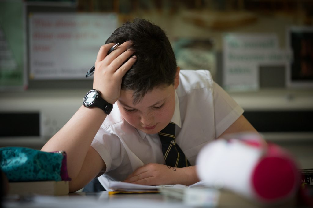 BRISTOL, UNITED KINGDOM - FEBRUARY 26:  A pupil reads during a english lesson at the Ridings Federation Winterbourne International Academy in Winterbourne near Bristol on February 26, 2015 in South Gloucestershire, England. Education, along with National Health Service and the economy are likely to be key election issues in the forthcoming general election in May.  (Photo by Matt Cardy/Getty Images)