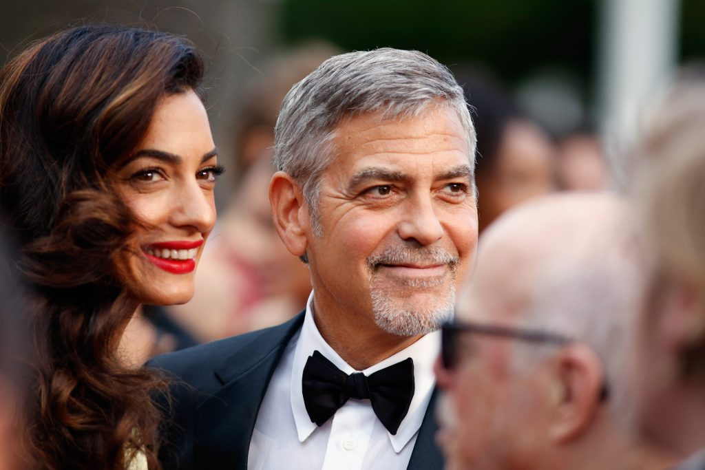 """CANNES, FRANCE - MAY 12:  Lawyer Amal Clooney (L) and actor George Clooney attend a screening of """"Money Monster"""" at the annual 69th Cannes Film Festival at Palais des Festivals on May 12, 2016 in Cannes, France.  (Photo by Tristan Fewings/Getty Images)"""