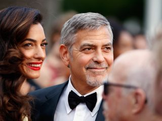 "CANNES, FRANCE - MAY 12:  Lawyer Amal Clooney (L) and actor George Clooney attend a screening of ""Money Monster"" at the annual 69th Cannes Film Festival at Palais des Festivals on May 12, 2016 in Cannes, France.  (Photo by Tristan Fewings/Getty Images)"