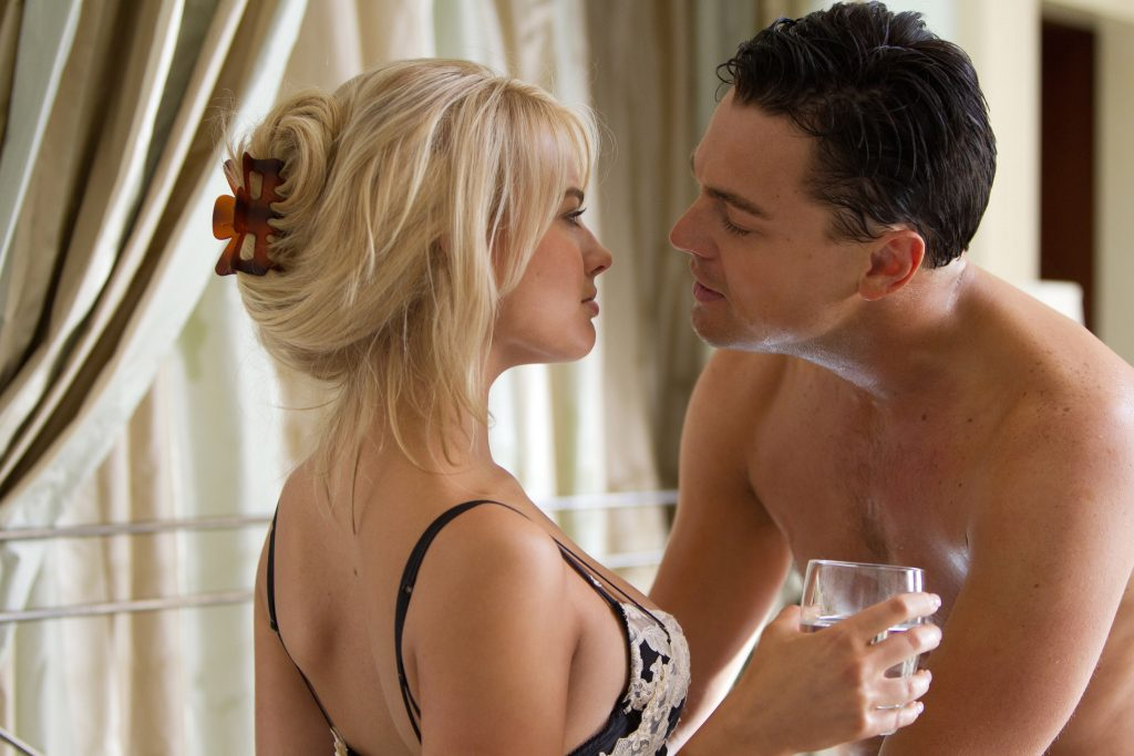 Left to right: Margot Robbie plays Naomi and Leonardo DiCaprio plays Jordan Belfort in THE WOLF OF WALL STREET, from Paramount Pictures and Red Granite Pictures.
