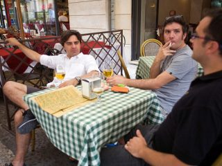 Men drinking beer at a cafe in the streets of Verona, Italy (Photo by In Pictures Ltd./Corbis via Getty Images)