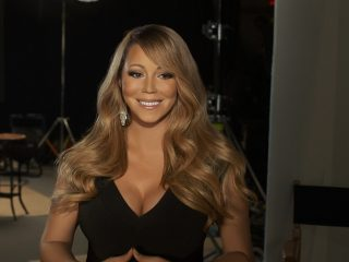 "UNSPECIFIED - FEBRUARY 13:  In this handout image provided by CF Publicity, Singer Mariah Carey smiles in an unspecified location on February 13, 2013. Carey has recorded the song, ""Almost Home"" for the soundtrack to the Disney feature film ""Oz The Great and Powerful"" directed by Sam Raimi in theatres in the US on March 8.  (Photo by CF Publicity via Getty Images)"