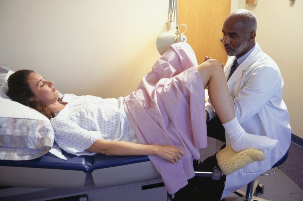 Patient having gynaecological examination