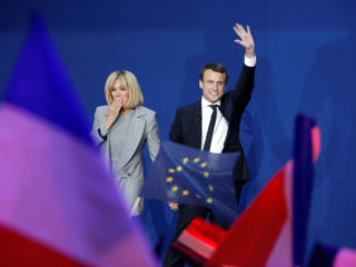 PARIS, FRANCE - APRIL 23:  Founder and Leader of the political movement 'En Marche !' Emmanuel Macron, flanked by his wife Brigitte Trogneux, speaks after projected results suggest that he has won the lead percentage of votes in the first round of the French Presidential Elections at Parc des Expositions Porte de Versailles on April 23, 2017 in Paris, France. Macron and National Front Party Leader Marine Le Pen, will compete in the next round of the French Presidential Elections on May 7 to decide the next President of France.  (Photo by Sylvain Lefevre/Getty Images)