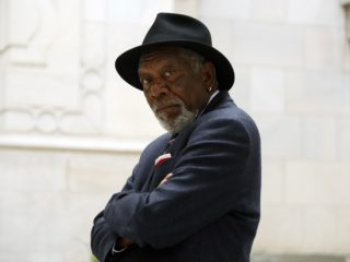 WASHINGTON, DC - Morgan Freeman looks back at the camera, while standing outside of the Islamic Center of Washington. (Photo Credit: National Geographic/Reza Riazi)