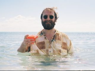 man-drinking-cocktail-in-sea-527588079-570f23bd5f9b5814089738fc