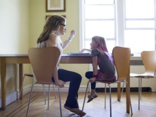 mother-helping-daughter-with-homework-540036109-59444c225f9b58d58a418358