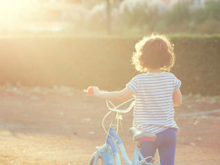 Girl (6-7) with her bike