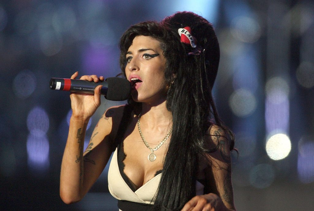 LONDON - JUNE 27:  Amy Winehouse performs during the 46664 concert in celebration of Nelson Mandela's life at Hyde Park on June 27, 2008 in London, England.  (Photo by Dan Kitwood/Getty Images)