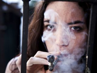 woman-smoking-pot-56a6fef15f9b58b7d0e5e5f8