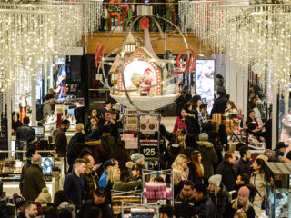 """NEW YORK, NY - NOVEMBER 23:  People shop at Macy's department store on """"Black Friday"""" on November 23, 2017 in New York City. Black Friday starts earlier in the season on Thanksgiving Day instead of the Friday after. (Photo by Stephanie Keith/Getty Images)"""