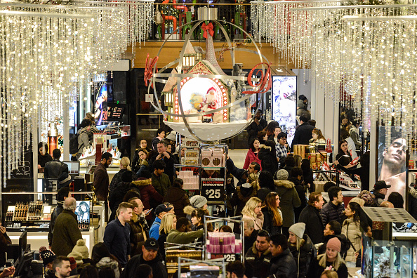 "NEW YORK, NY - NOVEMBER 23:  People shop at Macy's department store on ""Black Friday"" on November 23, 2017 in New York City. Black Friday starts earlier in the season on Thanksgiving Day instead of the Friday after. (Photo by Stephanie Keith/Getty Images)"