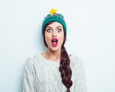 Surprised woman in winter outfit