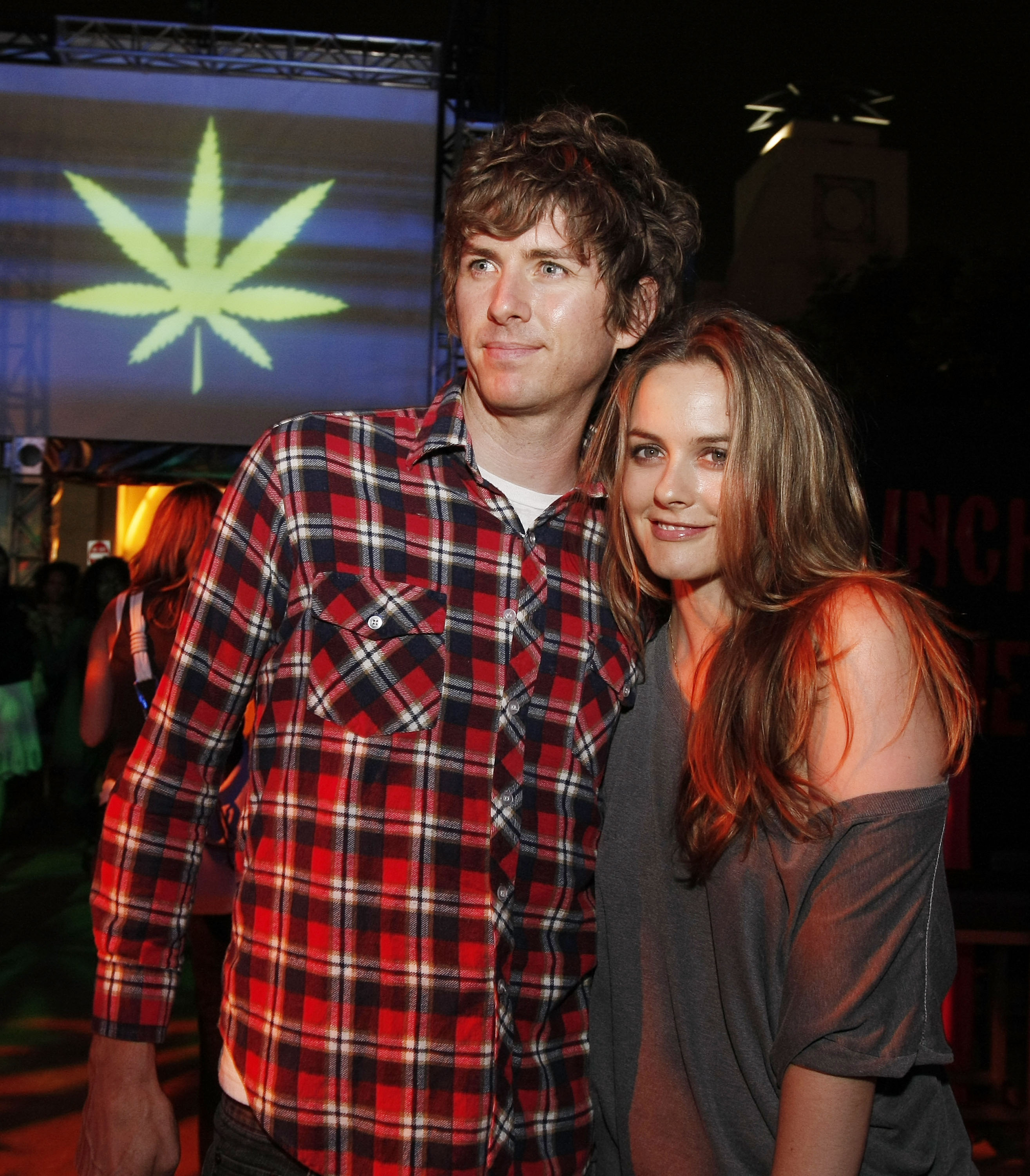 "LOS ANGELES, CA - JULY 31: Actress Alicia Silverstone (R) and husband Christopher Jarecki pose at the afterparty for the premiere of Columbia Picture's ""Pineapple Express"" at the Mann Village Theater on July 31, 2008 in Los Angeles, California. (Photo by Kevin Winter/Getty Images)"
