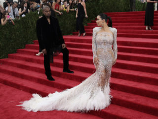 """NEW YORK, NY - MAY 04:  Kim Kardashian and Kanye West attend the """"China: Through The Looking Glass"""" Costume Institute Benefit Gala at the  Metropolitan Museum of Art on May 4, 2015 in New York City.  (Photo by Neilson Barnard/Getty Images)"""