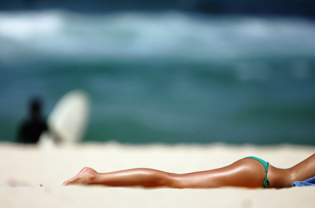 SYDNEY, NSW - NOVEMBER 03:  A sunbather soaks up the summer sun on Bondi Beach November 3, 2005 in Sydney, Australia. Forecasters are predicting record temperatures in Australia this summer, which could see a 2 degree celcius rise in average temperatures for the season.  (Photo by Ian Waldie/Getty Images)