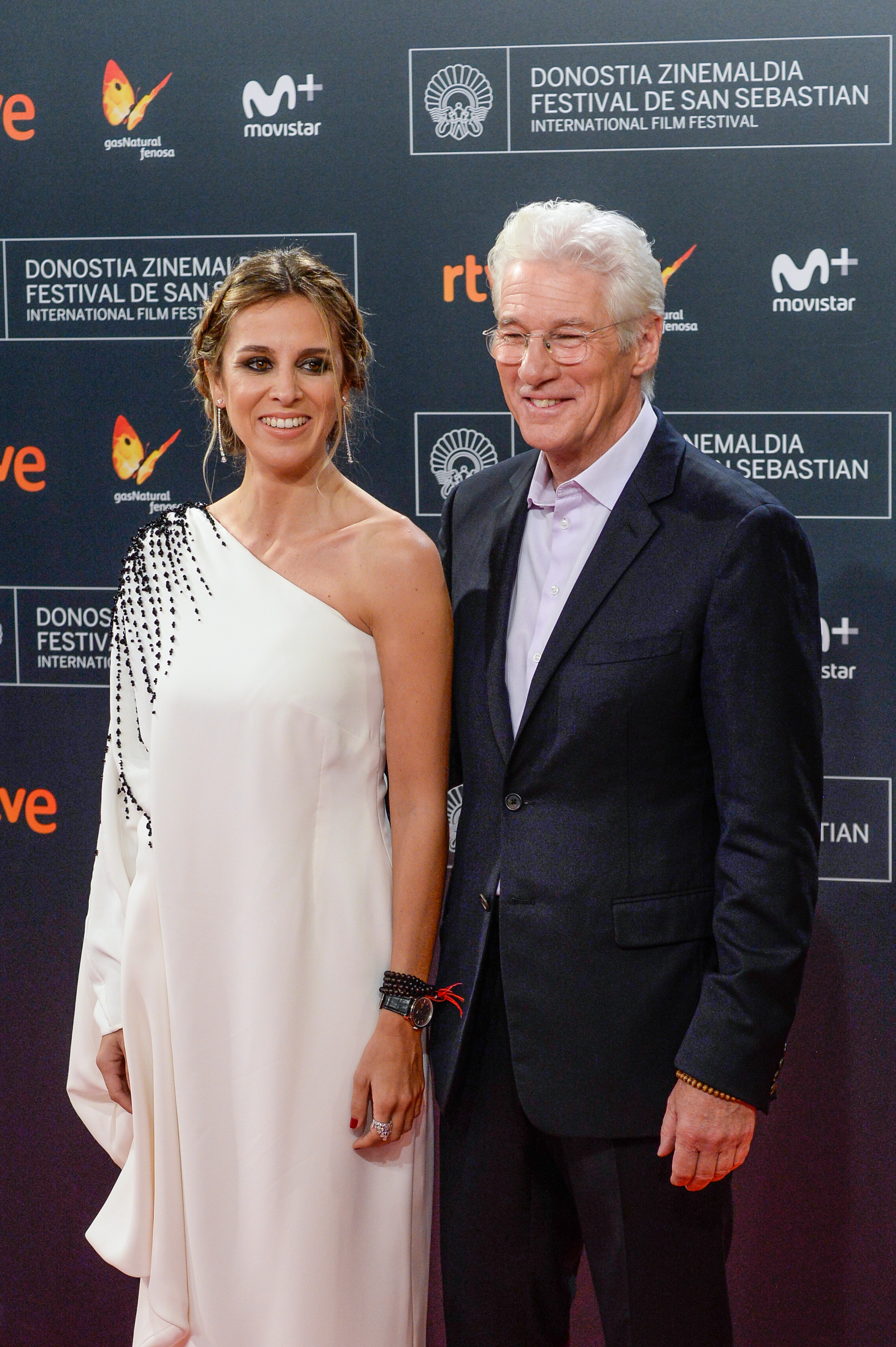 SAN SEBASTIAN, SPAIN - SEPTEMBER 24: Alejandra Silva and Richard Gere attends the red carpet of the closing gala of 64th San Sebastian Film Festival at Kursaal on September 24, 2016 in San Sebastian, Spain. (Photo by Carlos Alvarez/Getty Images)
