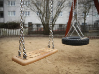 "BERLIN, GERMANY - MARCH 29:  A swing stands at a playground at the ""Abenteuerland"" child daycare center during a visit by German Family Minister Franziska Giffey (not pictured) on March 29, 2018 in Berlin, Germany. Giffey is seeking measures to help fill the need for more daycare centers and availability across Germany. While German law guarantees families daycare for their small children, insufficient daycare facilities and personnel are leaving a gap of hundreds of thousands unavailable spots for children.  (Photo by Sean Gallup/Getty Images)"