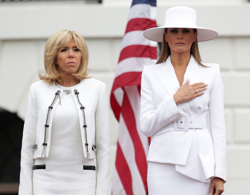 WASHINGTON, DC - APRIL 24:  U.S. first lady Melania Trump (R) and French first lady Brigitte Macron (L) participate in a state arrival ceremony at the South Lawn of the White House April 24, 2018 in Washington, DC. Trump is hosting French President Emmanuel Macron for a two-day official visit that includes dinner at George Washington's Mount Vernon, a tree planting on the White House South Lawn, an Oval Office meeting, a joint news conference and a state dinner.  (Photo by Alex Wong/Getty Images)