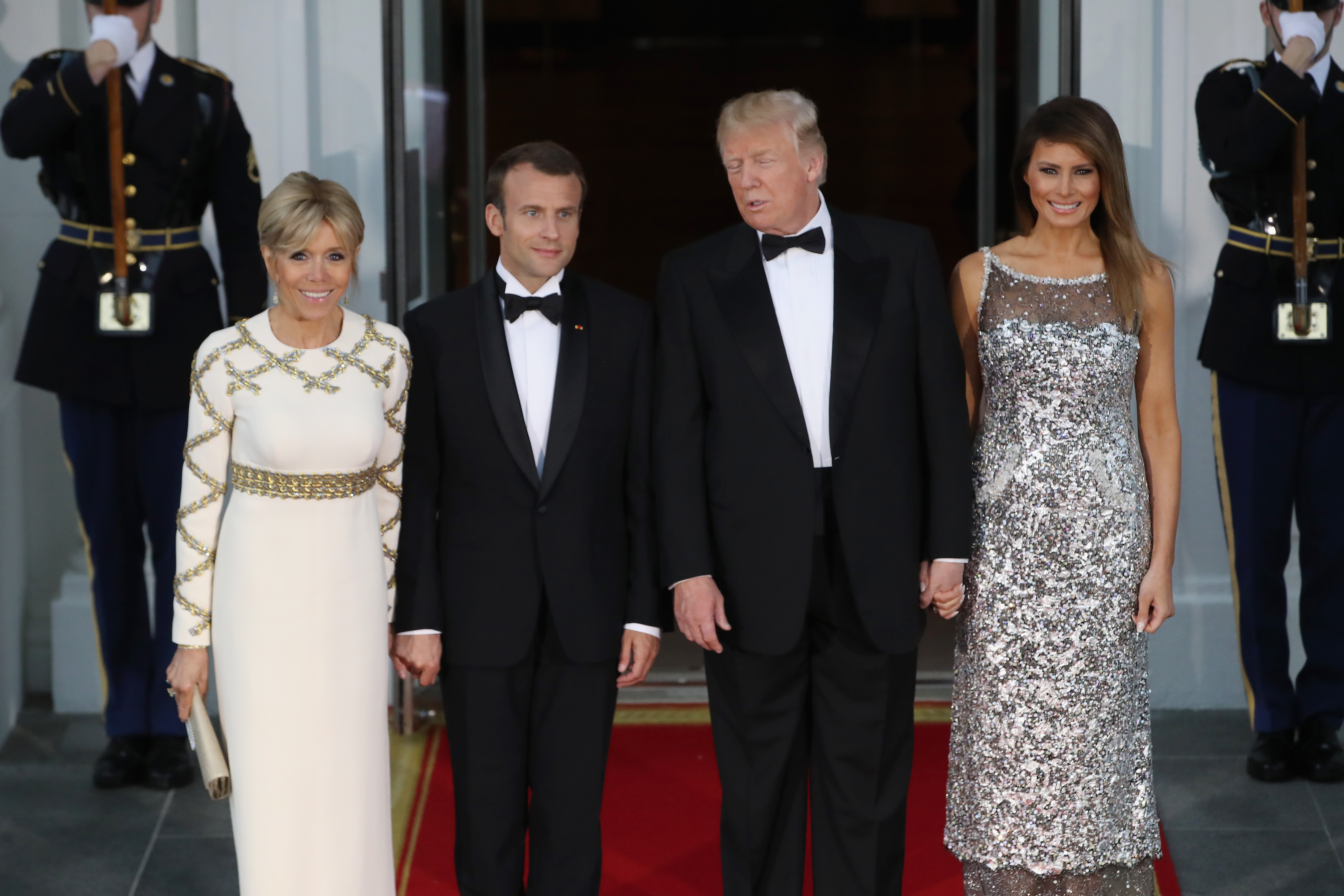 WASHINGTON, DC - APRIL 24: U.S President Donald Trump and U.S. first lady Melania Trump stand with French President Emmanuel Macron and French first lady Brigitte Macron after their arrival at the North Portico before a State Dinner at the White House, April 24, 2018 in Washington, DC. Trump is hosting Macron for a two-day official visit that included dinner at George Washington's Mount Vernon, a tree planting on the White House South Lawn and a joint news conference. (Photo by Mark Wilson/Getty Images)