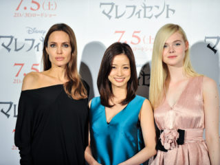 "TOKYO, JAPAN - JUNE 24:  (L-R) Angelina Jolie, Aya Ueto and Elle Fanning attend ""Maleficent"" press conference for the Japan premiere at Grand Hyatt Tokyo on June 24, 2014 in Tokyo, Japan.  (Photo by Keith Tsuji/Getty Images)"