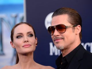 "HOLLYWOOD, CA - MAY 28:  Actors Angelina Jolie (L) and Brad Pitt attend the World Premiere of Disney's ""Maleficent"" at the El Capitan Theatre on May 28, 2014 in Hollywood, California.  (Photo by Frazer Harrison/Getty Images)"