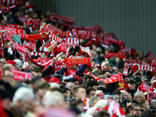 LIVERPOOL, ENGLAND - JANUARY 27:  Liverpool supporters hold up their scarves as they sing prior to The Emirates FA Cup Fourth Round match between Liverpool and West Bromwich Albion at Anfield on January 27, 2018 in Liverpool, England.  (Photo by Alex Livesey/Getty Images)