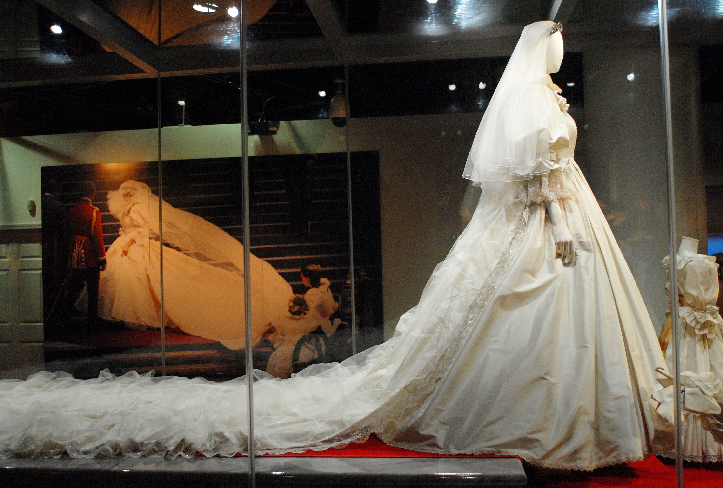 "PHILADELPHIA - OCTOBER 1: Princess Diana's wedding gown is displayed at a preview of the traveling ""Diana: A Celebration"" exhibit at the National Constitution Center on October 1, 2009 in Philadelphia, Pennsylvania. The exhibit, not shown in the U.S. since 2007, opens tomorrow and continues through December 31. (Photo by William Thomas Cain/Getty Images)"