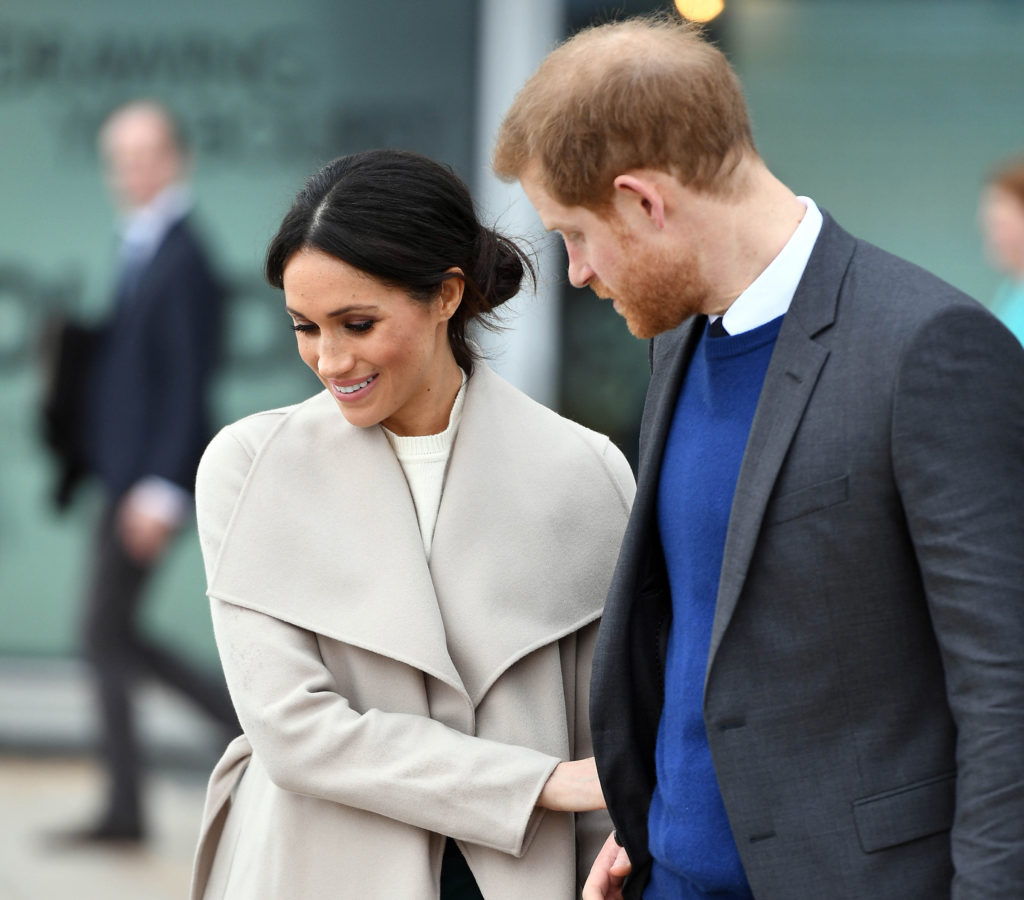 BELFAST, NORTHERN IRELAND - MARCH 23:  Prince Harry and Meghan Markle during a visit to Titanic Belfast maritime museum on March 23, 2018 in Belfast, Nothern Ireland. (Photo by Andrew Parsons - Pool/Getty Images)