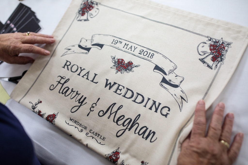 SPILSBY, ENGLAND - APRIL 30: Worker Lynne Needham folds and packages commemorative tea towels by Victoria Eggs to mark the wedding of Prince Harry to Meghan Markle at Countryside Art Ltd on April 30, 2018 in Spilsby, England. The Centre for Retail Research estimates that £30 million of memorabilia will be sold to mark the May 19th royal wedding. (Photo by Jack Taylor/Getty Images)