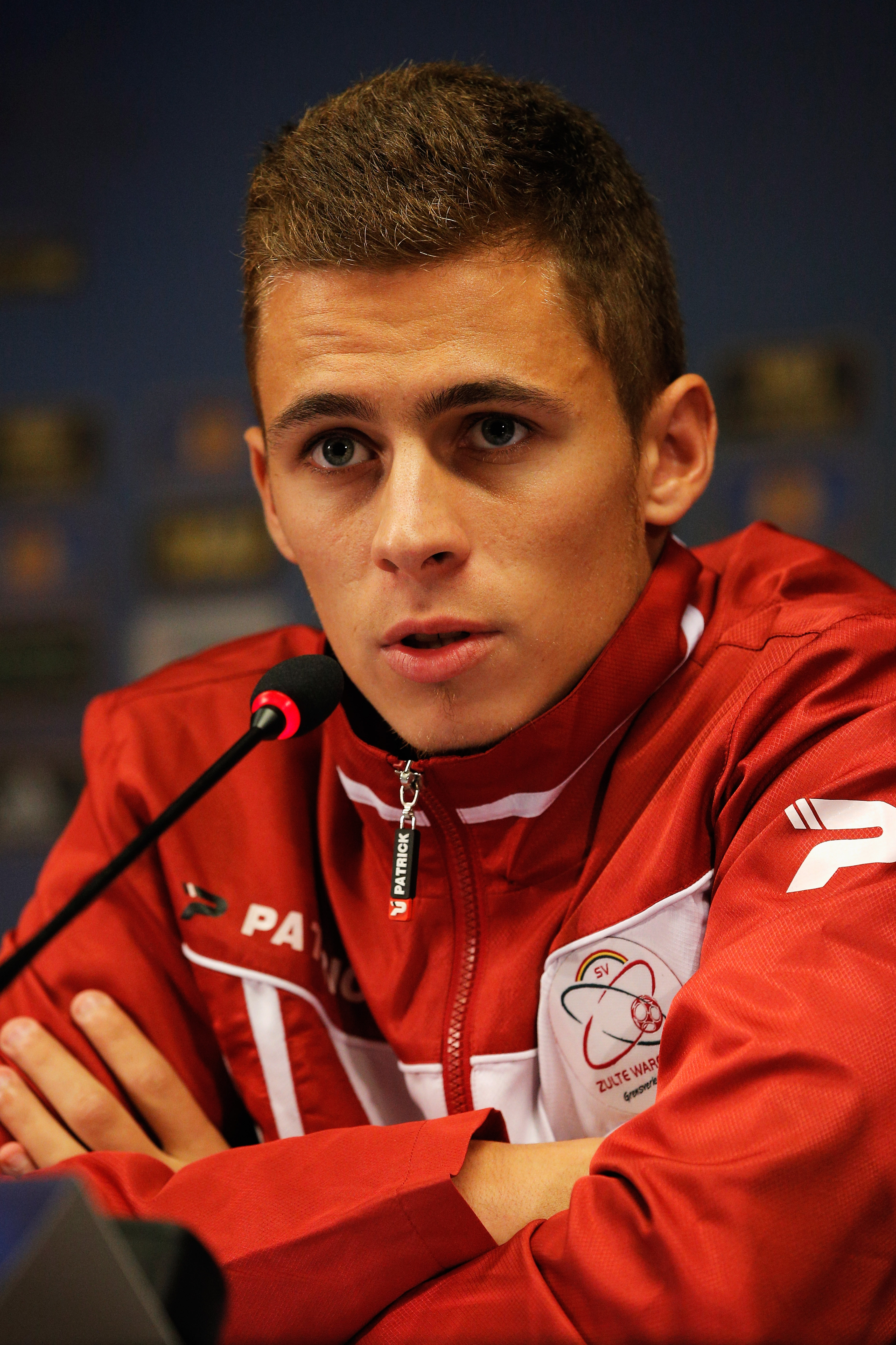 BRUSSELS, BELGIUM - SEPTEMBER 18: Thorgan Hazard speaks to the media during the SV Zulte Waregem Press Conference prior to the Europa League match between SV Zulte Waregem and Wigan Athletic at the Jan Breydelstadium on September 18, 2013 in Brussels, Belgium. (Photo by Dean Mouhtaropoulos/Getty Images)