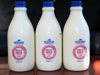 AUCKLAND, NEW ZEALAND - JUNE 10:  In this photo illustration, bottles of the red label Lewis Road Creamery 1.5 litre milk are seen on June 10, 2015 in Auckland, New Zealand. Breastfeeding advocates have slammed Lewis Road Creamery's New 'Breast Milk', labeling it as misguided advertising and disrespectful toward women. The red label bottle which reads: 'Breast Milk: the cow's milk that funds the cure', Lewis Road Creamery will be donating 20 cents to Breast Cancer Cure.  (Photo by Fiona Goodall/Getty Images)