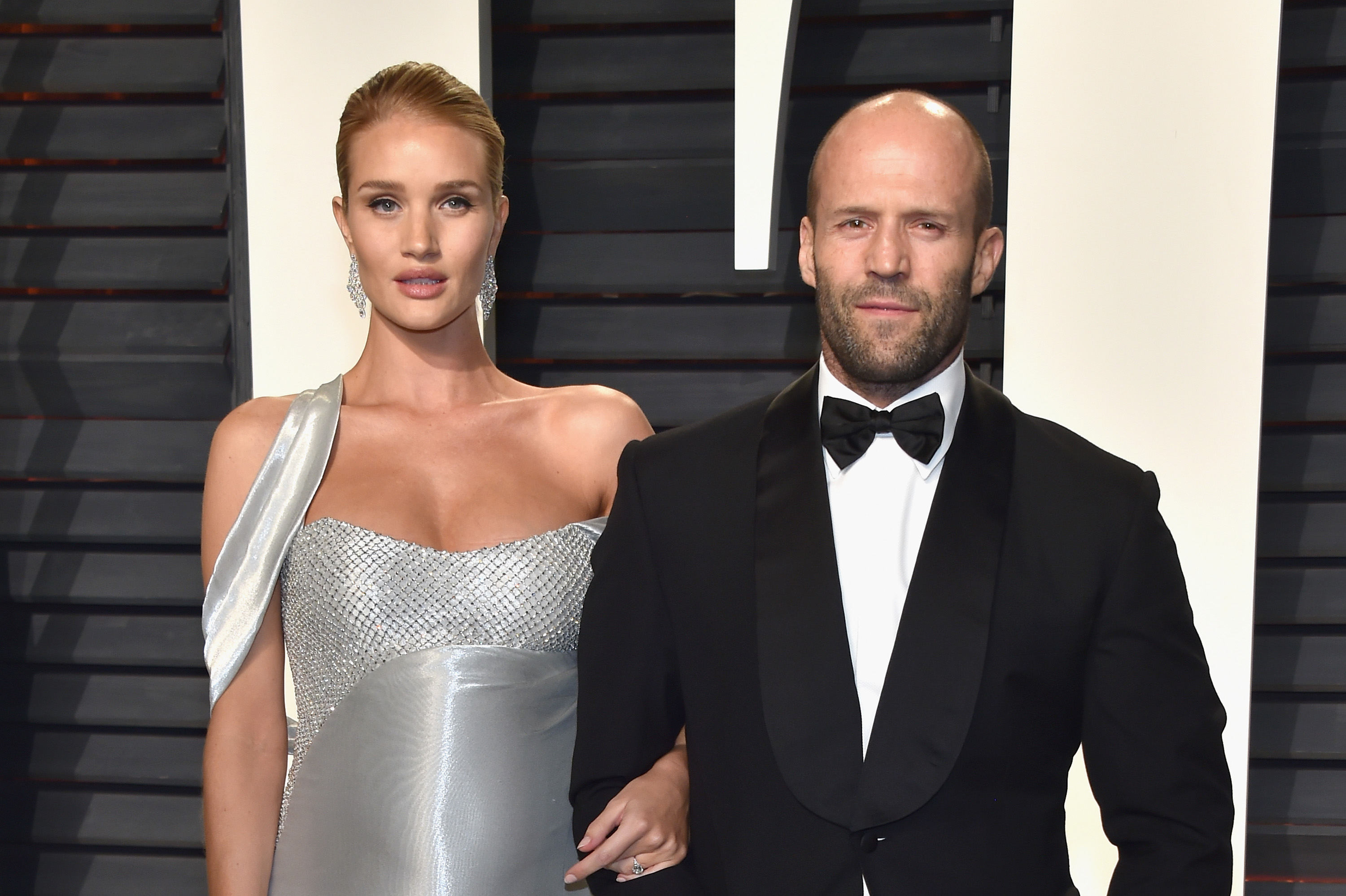 BEVERLY HILLS, CA - FEBRUARY 26:  Model-actor Rosie Huntington-Whiteley (L) and actor Jason Statham attend the 2017 Vanity Fair Oscar Party hosted by Graydon Carter at Wallis Annenberg Center for the Performing Arts on February 26, 2017 in Beverly Hills, California.  (Photo by Pascal Le Segretain/Getty Images)