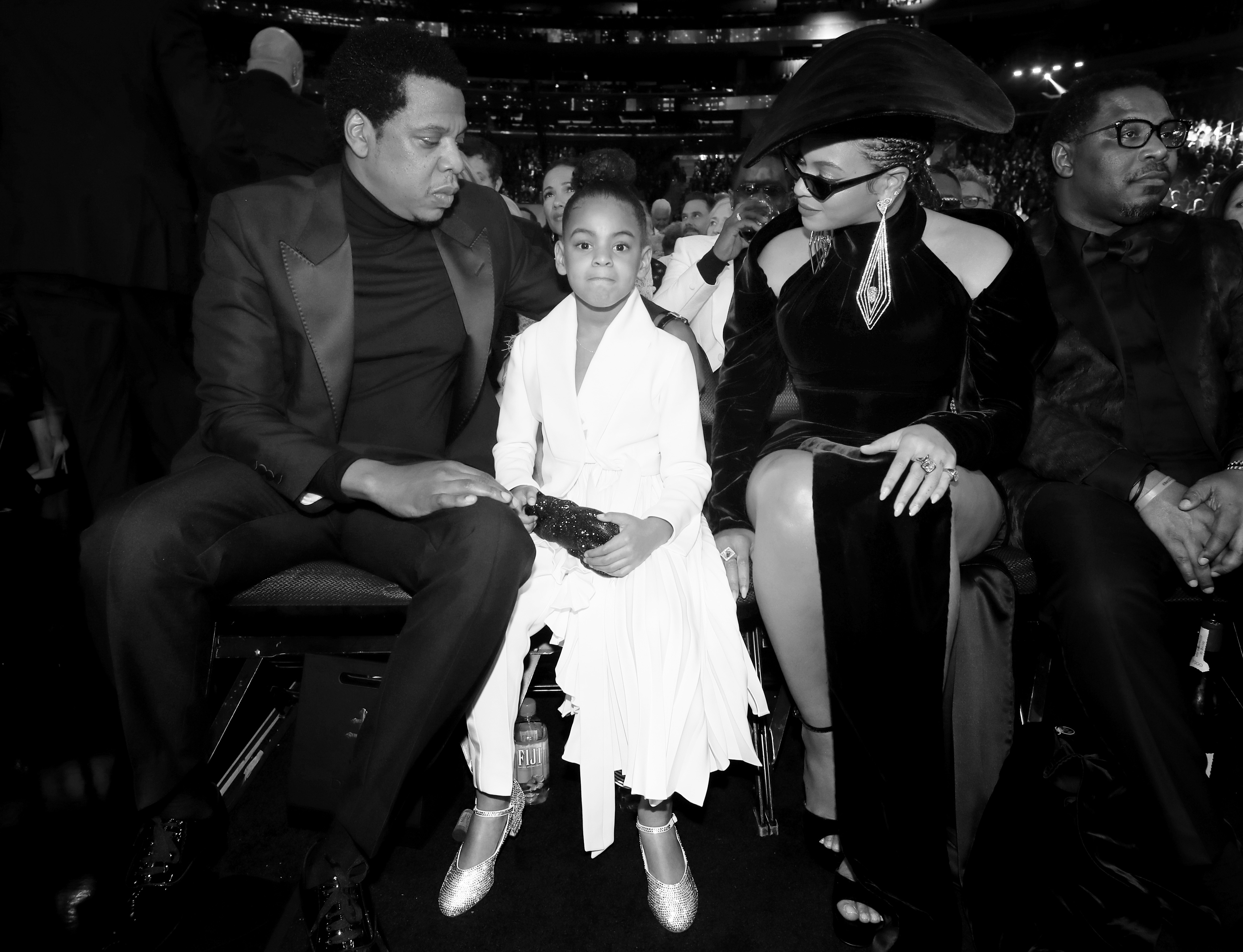 NEW YORK, NY - JANUARY 28:  (EDITOR'S NOTE: Image has been converted to black and white.)  (L-R) Recording artist Jay-Z, Blue Ivy Carter and recording artist Beyonce attend the 60th Annual GRAMMY Awards at Madison Square Garden on January 28, 2018 in New York City.  (Photo by Christopher Polk/Getty Images for NARAS)