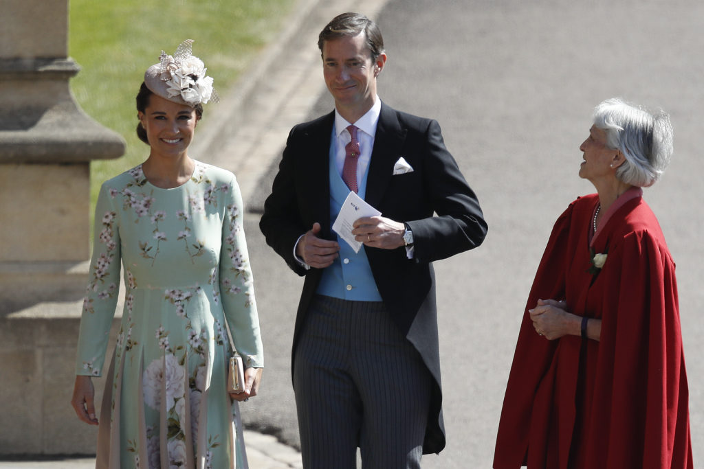 WINDSOR, UNITED KINGDOM - MAY 19:  Pippa Middleton (L) and her husband James Matthews arrive at St George's Chapel at Windsor Castle before the wedding of Prince Harry to Meghan Markle on May 19, 2018 in Windsor, England. (Photo by Odd ANDERSEN - WPA Pool/Getty Images)