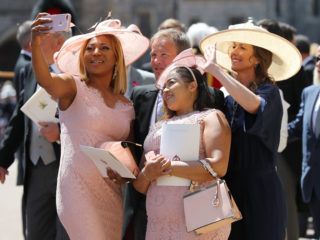 WINDSOR, UNITED KINGDOM - MAY 19:  Weddding guests take a selfie outside St George's Chapel at Windsor Castle after the wedding of Prince Harry to Meghan Markle on May 19, 2018 in Windsor, England. (Photo by Gareth Fuller - WPA Pool/Getty Images)