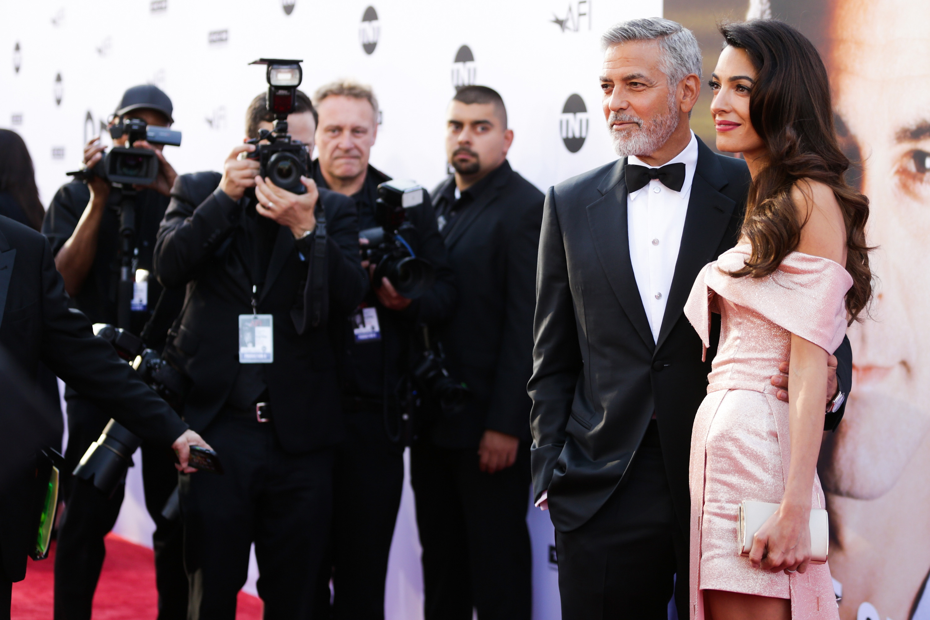 HOLLYWOOD, CA - JUNE 07:  Honoree George Clooney (L) and Amal Clooney attend the American Film Institute's 46th Life Achievement Award Gala Tribute to George Clooney at Dolby Theatre on June 7, 2018 in Hollywood, California.  (Photo by Rich Fury/Getty Images)