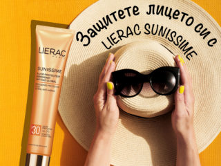 Hands of young girl holding straw hat and sunglasses on vibrant yellow background. Top View. Summer Travel Vacation Concept.