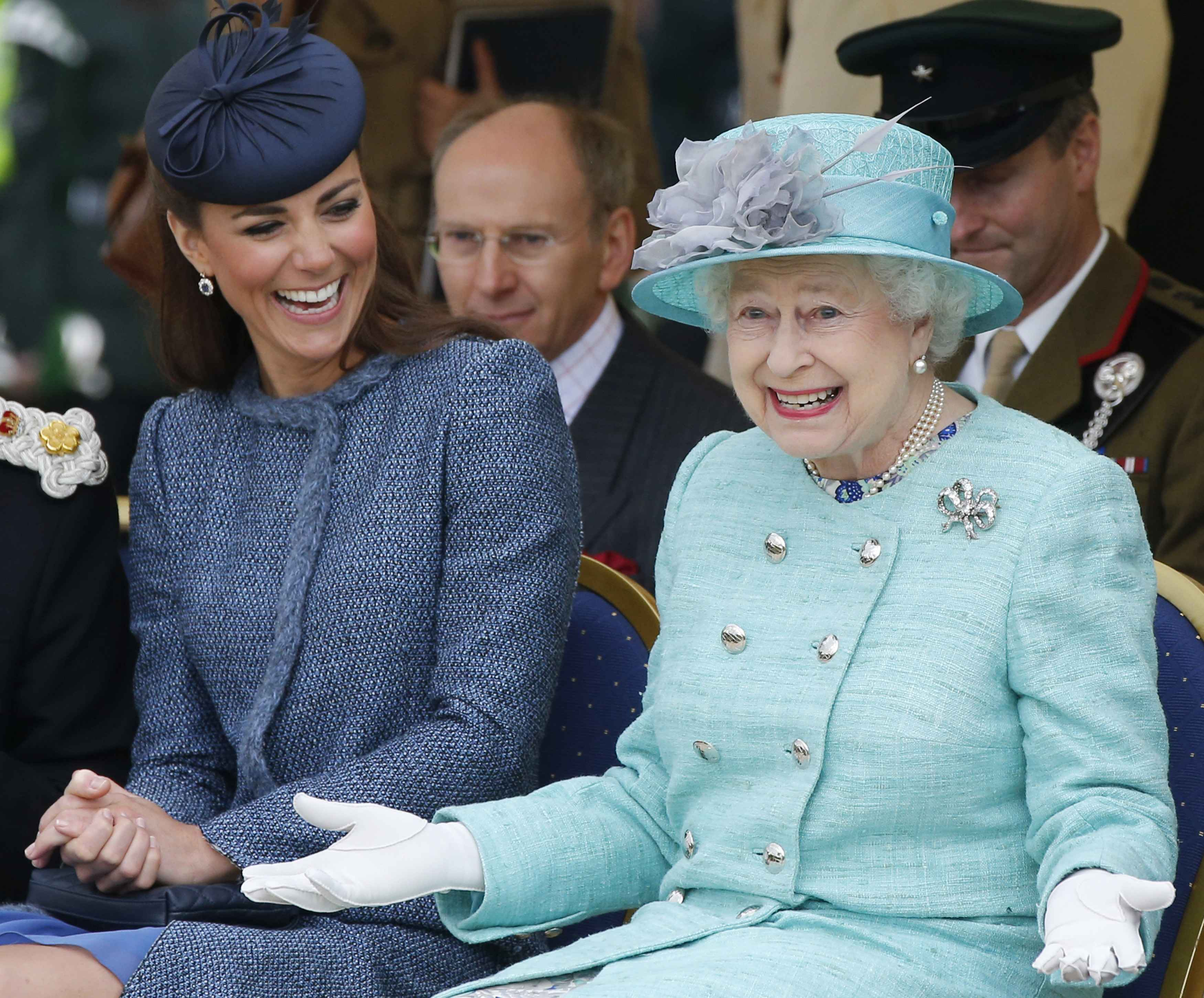 NOTTINGHAM, ENGLAND - JUNE 13: Catherine, Duchess of Cambridge and Queen Elizabeth II watch part of a children's sports event while visiting Vernon Park during a Diamond Jubilee visit to Nottingham on June 13, 2012 in Nottingham, England. (Photo by Phil Noble - WPA Pool/Getty Images)