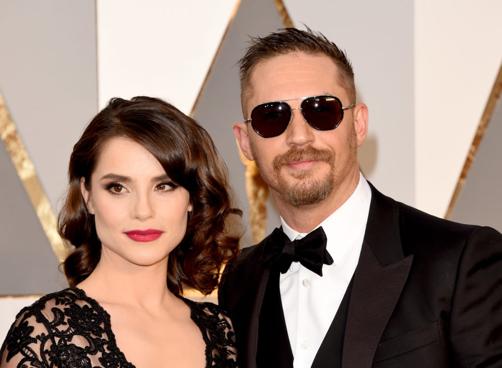 HOLLYWOOD, CA - FEBRUARY 28:  Actors Tom Hardy (R) and Charlotte Riley attend the 88th Annual Academy Awards at Hollywood & Highland Center on February 28, 2016 in Hollywood, California.  (Photo by Jason Merritt/Getty Images)