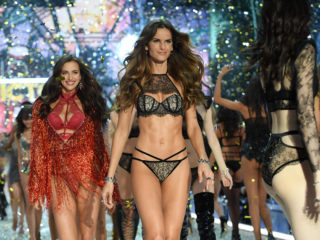 PARIS, FRANCE - NOVEMBER 30:  Irina Shayk and Izabel Goulart walk the runway during the 2016 Victoria's Secret Fashion Show on November 30, 2016 in Paris, France.  (Photo by Dimitrios Kambouris/Getty Images for Victoria's Secret)