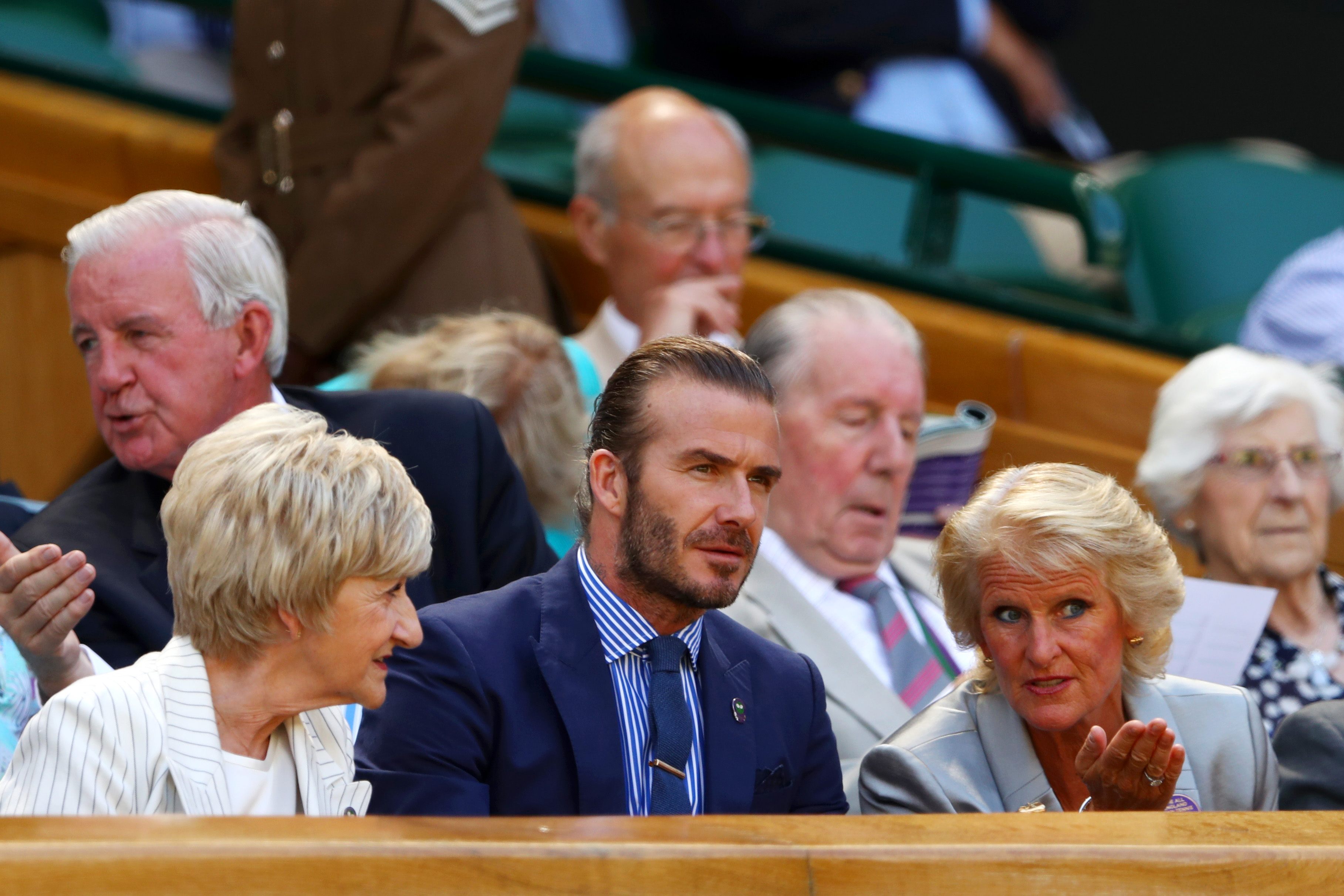LONDON, ENGLAND - JULY 07: Gill Brook in discussion with David Beckham and Sandra Beckham in the centre court royal box on day five of the Wimbledon Lawn Tennis Championships at the All England Lawn Tennis and Croquet Club on July 7, 2017 in London, England. (Photo by Michael Steele/Getty Images)