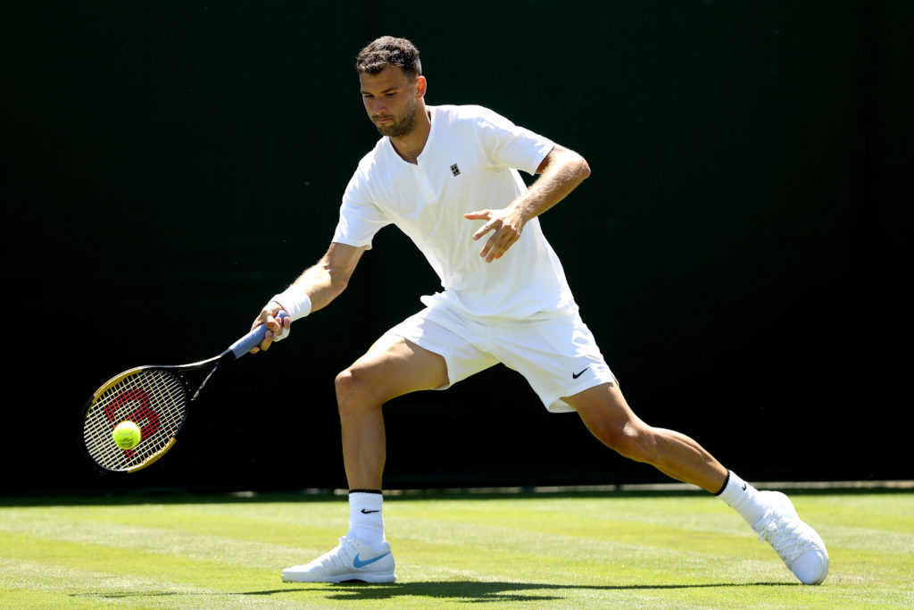 LONDON, ENGLAND - JUNE 30:  Grigor Dimitrov of Bulgaria practices on court during training for the Wimbledon Lawn Tennis Championships at the All England Lawn Tennis and Croquet Club at Wimbledon on June 30, 2018 in London, England.  (Photo by Matthew Stockman/Getty Images)