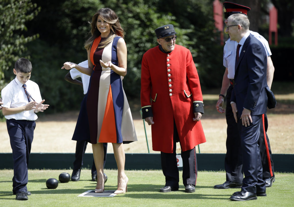 "LONDON, ENGLAND - JULY 13: U.S. First Lady Melania Trump gestures as she plays bowls with Philip May, the husband of British Prime Minister Theresa May during a visit to British military veterans known as ""Chelsea Pensioners"" at Royal Hospital Chelsea on July 13, 2018 in London, England. America's First Lady visited the Chelsea Pensioners while her husband, President Donald Trump, held bi-lateral talks with Theresa May at the Prime Minister's Country Residence.  The Chelsea Pensioners are British Army personnel who are cared for at at the Services retirement home at The Royal Hospital in London. (Photo by Luca Bruno - WPA Pool/Getty Images)"