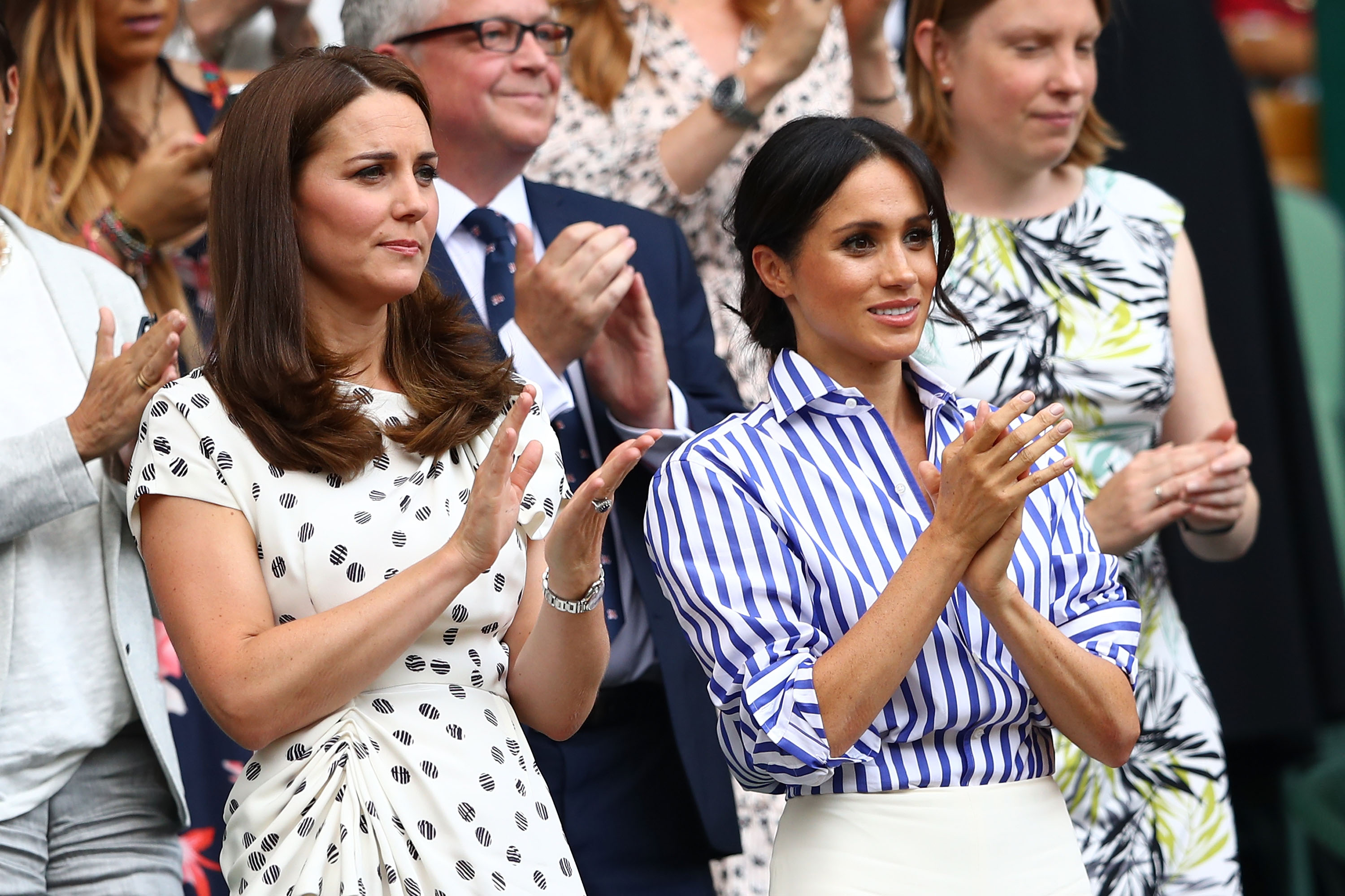 LONDON, ENGLAND - JULY 14: Catherine, Duchess of Cambridge and Meghan, Duchess of Sussex applaud ahead of the Ladies' Singles final match between Serena Williams of The United States and Angelique Kerber of Germany on day twelve of the Wimbledon Lawn Tennis Championships at All England Lawn Tennis and Croquet Club on July 14, 2018 in London, England. (Photo by Michael Steele/Getty Images)